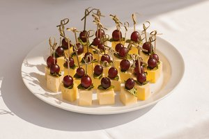 Appetizer with grapes and cheese. Canape