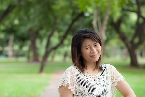 asian portrait in park.