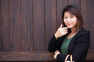 cute woman in wood background.