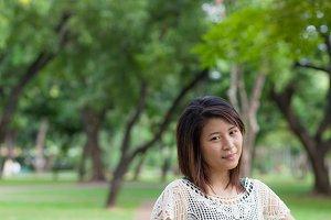 asian portrait in park.