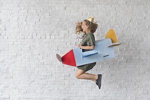 Woman jumping with aircraft