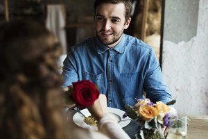 Romantic Man Giving a Rose