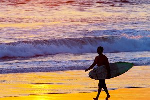 Surfer with surfboard, Bali