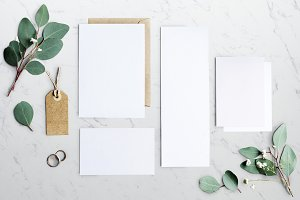 Blank Papers Laying on Marble Table