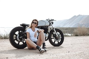 Biker girl and vintage custom motorcycle