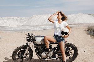 Female on custom built cafe racer motorcycle