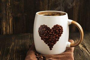 Mug of coffee and beans