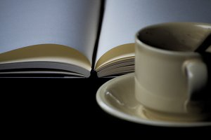book and a cup of coffee