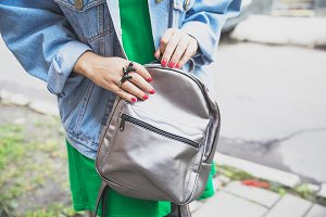 Fashion woman with silver backpack