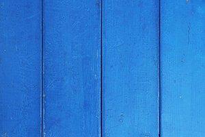 Blue painted across wood planks