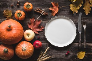 Autumnal table setting for Thanksgiving dinner or Halloween