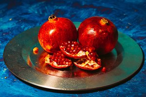 Red pomegranate on metal a plate