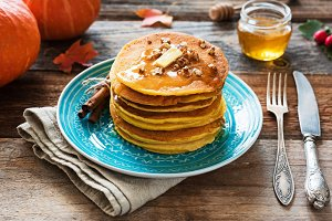 Pumpkin pancakes with butter, honey and nuts