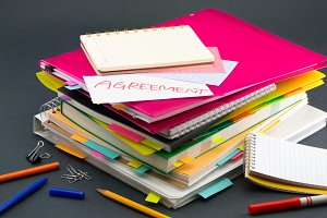 Stacked Documents on Your Desk