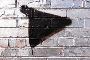 Play Sign Bricks Wall