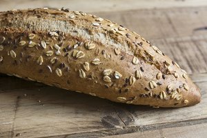 bread with seeds and nuts, on wood g