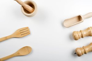 Wooden utensils for kitchen on white background. Copy space.