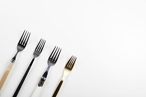 Forks on white background. Copy space.