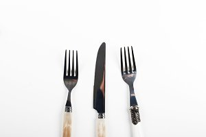 Forks and knife design on white background. Copy space.