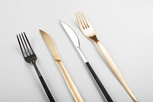 Forks and knives design on white background.