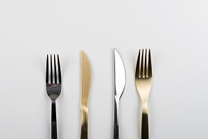 Background of forks and knives design on white background. Copy space.