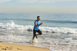Runner man training on the beach