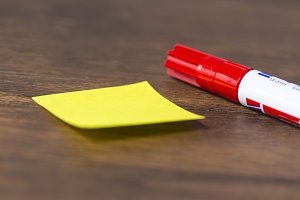 Yellow post-it with pen
