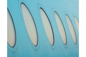 Close-up of the windows of an airplane outside.