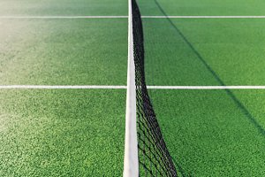 Tennis court net in summer