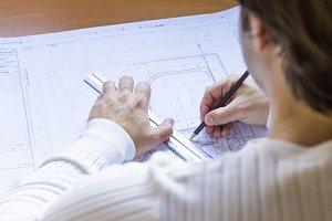 Man architect draws a plan