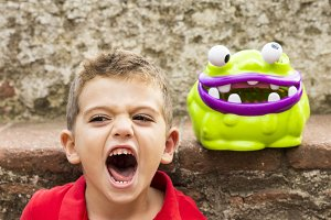 Child imitating a monster