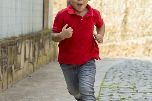 Boy running towards the camera