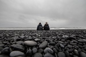 Young friends on black sand beach