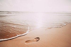 ooprint on sandy ocean beach