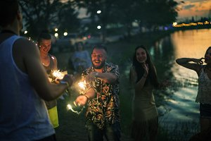 Diverse people enjoying sparklers