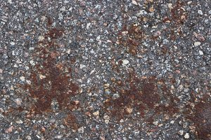 Road asphalt texture. Rusty stains