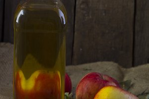 Apples and a bottle of oil