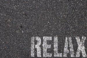 Road asphalt texture. Relax word