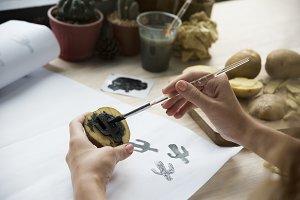 Woman Painting Potatoes