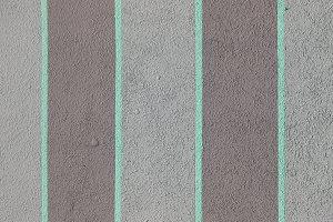 Turquoise stripes paint concrete