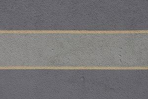 Yellow stripe paint concrete wall