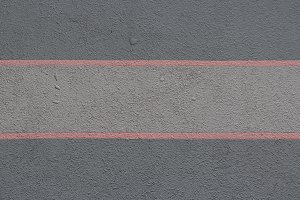 Red stripes paint concrete wall