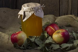 Apples with a jar of honey
