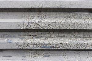 Weathered metallic corrugated wall.