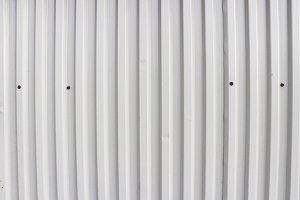 White metallic corrugated wall.