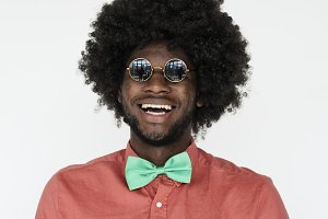 a man with an Afro wig and glasses