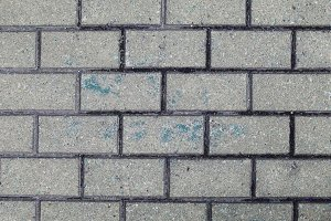 Blue paint on concrete bricks wall