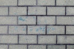 Blue paint on concrete bricks wall