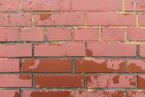 Red bricks wall weathered paint