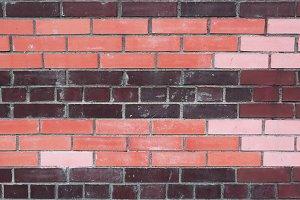 Dirty colored bricks wall texture